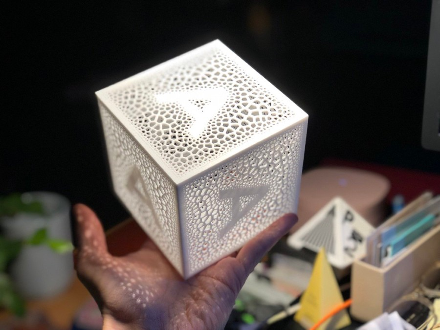 Hand holding cube with the letter A