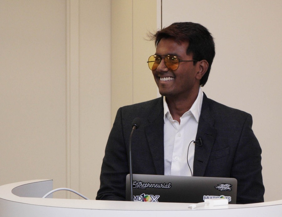 Image of Multidots CEO Anil Gupta in orange sunglasses presenting on the REST API at BigWP NYC