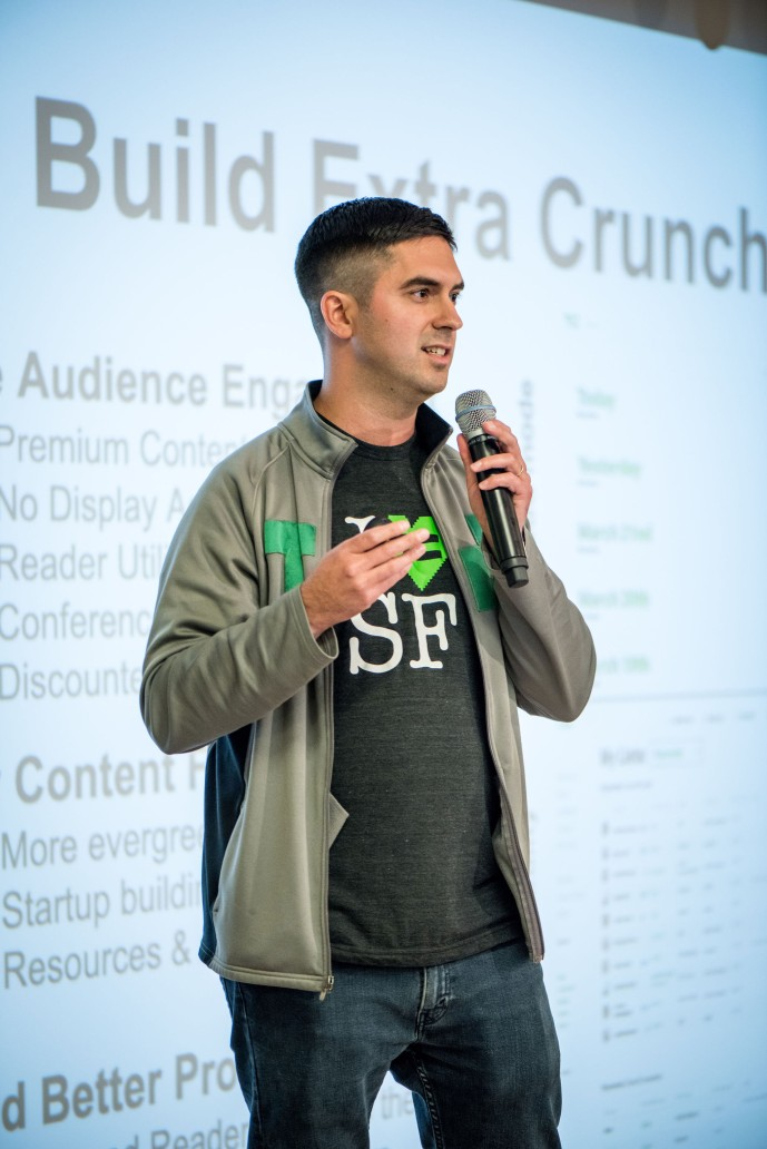 Image of Sam Singer on stage at BigWP SF discussing Extra Crunch, TechCrunch's paywall built on WordPress