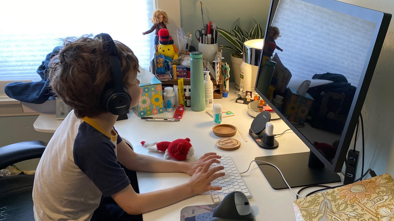 My son pretending to work at my desk